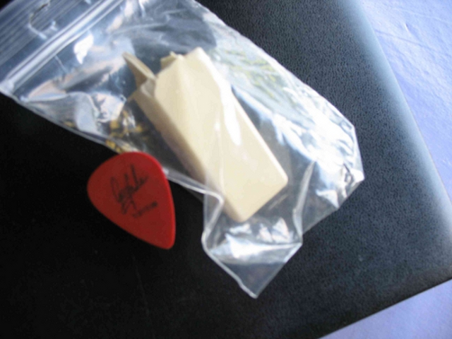 Original Key of Keith Emerson's Hammond organ, Model L 100 + Original Greg Lake Plectrum